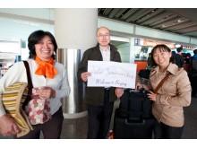 Džiaugsmingas sutikimas oro uoste.