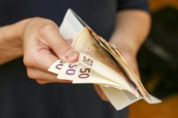 Kokių finansinių įpročių turėtumėte laikytis: metinis planas