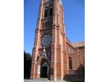 K. E. Strandmanno projektuotoji Palangos bažnyčia - raudonų plytų ir balto tinko simfonija...