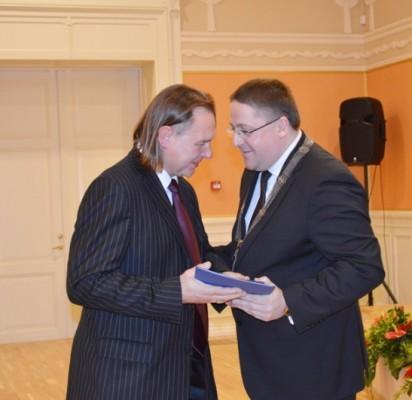 Apdovanojimas – Gintarui Sičiūnui.